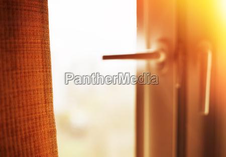 window curtain with light leak bokeh
