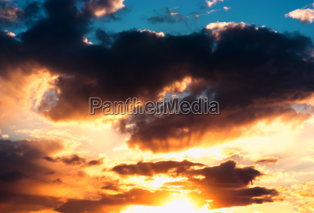 dramatic sunset cloudscape with sun rays