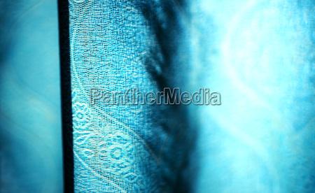 horizontal vivid blue curtain bokeh background