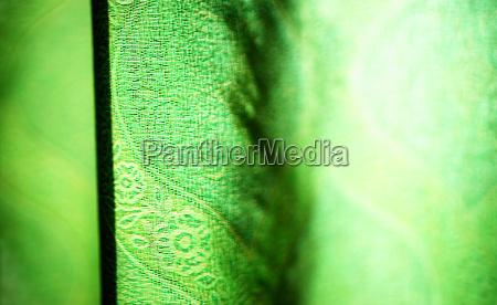 horizontal vivid green curtain bokeh background