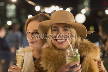 portrait smiling young women drinking cocktails