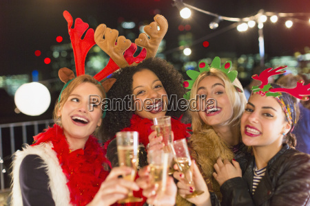 portrait enthusiastic young women wearing christmas
