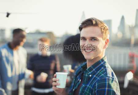 portrait smiling young man drinking at