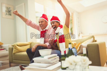 enthusiastic mature couple in matching hats