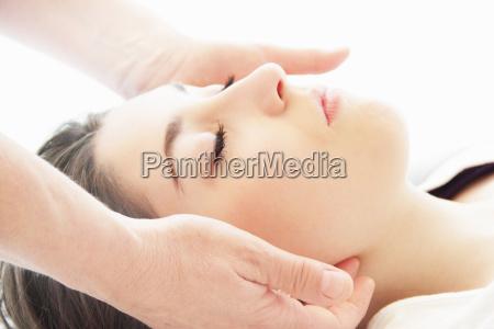 woman having facial massage in spa