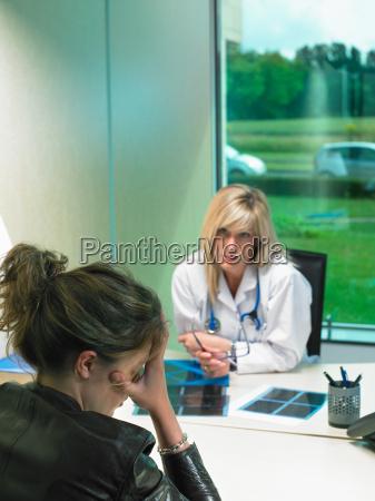 concerned female doctor at her desk