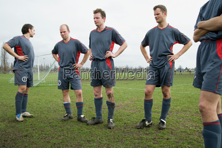 footballers standing on the pitch