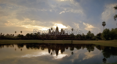 view across lake of stone ruins