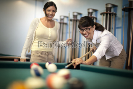 two young woman playing a friendly