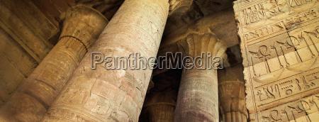 looking up at ancient stone columns