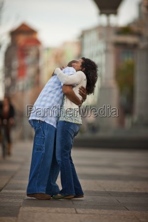 happy young couple embracing in a