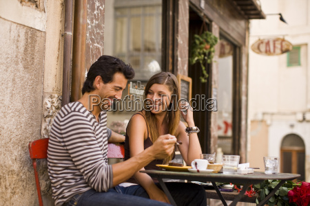 happy mid adult couple sitting at