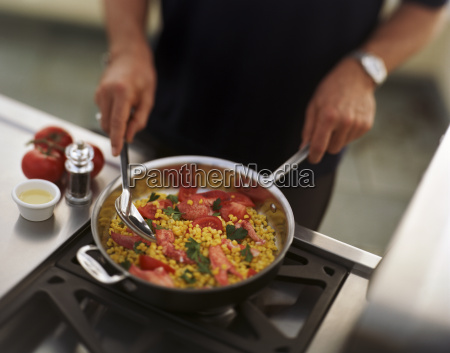 large pan of corn and tomato
