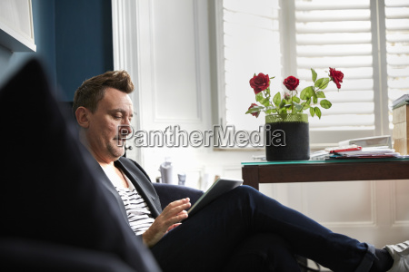 man sitting in an office using