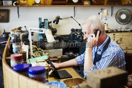 a clock maker busy in his