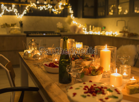 champagne and desserts on candlelight christmas