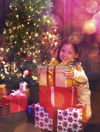 portrait smiling girl with stack of