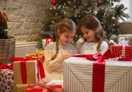 sisters surrounded by christmas gifts