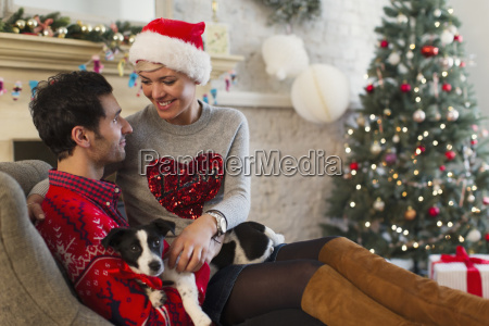 affectionate couple with dog relaxing in