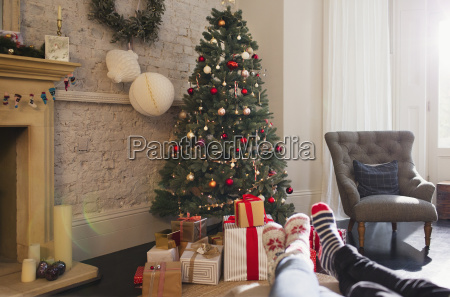 relaxed couple wearing socks with feet