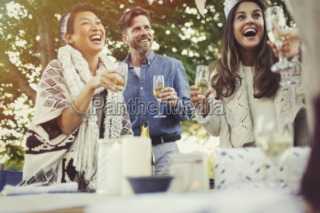 friends laughing and drinking champagne at