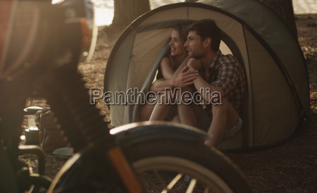 affectionate young couple in tent
