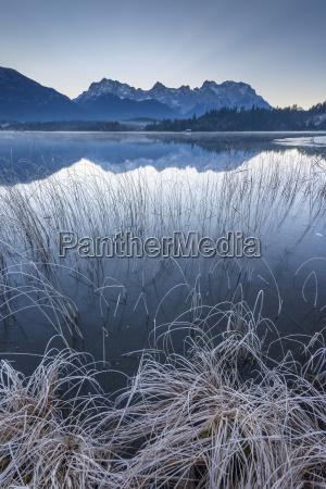 karwendel mountains reflected in lake barmsee