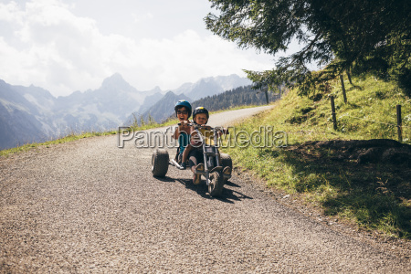 mother and son wearing helmets riding