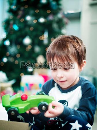 boy opening christmas presents