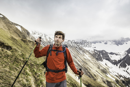 young man mountain trekking in bavarian