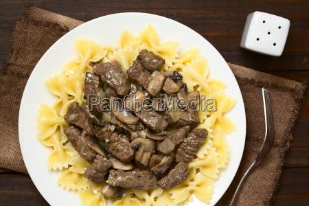 beef stroganoff on farfalle pasta