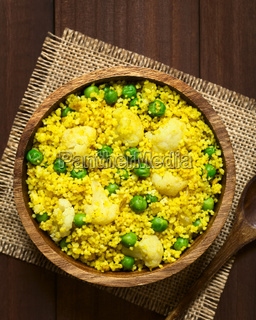curried couscous with pea and cauliflower