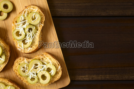 crostini with green olives and cheese