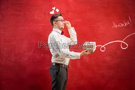 young funny man with gift