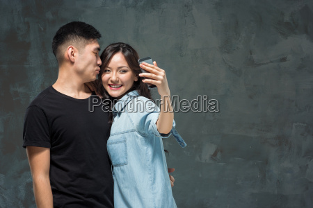 portrait of smiling korean couple on