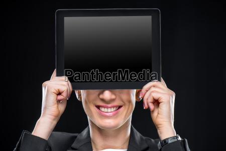 businesswoman showing digital tablet