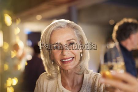 portrait smiling senior woman toasting white