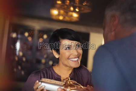 grateful woman receiving gift from husband
