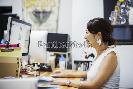 design studio a woman sitting at