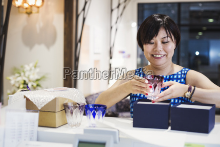 saleswoman in a shop selling edo