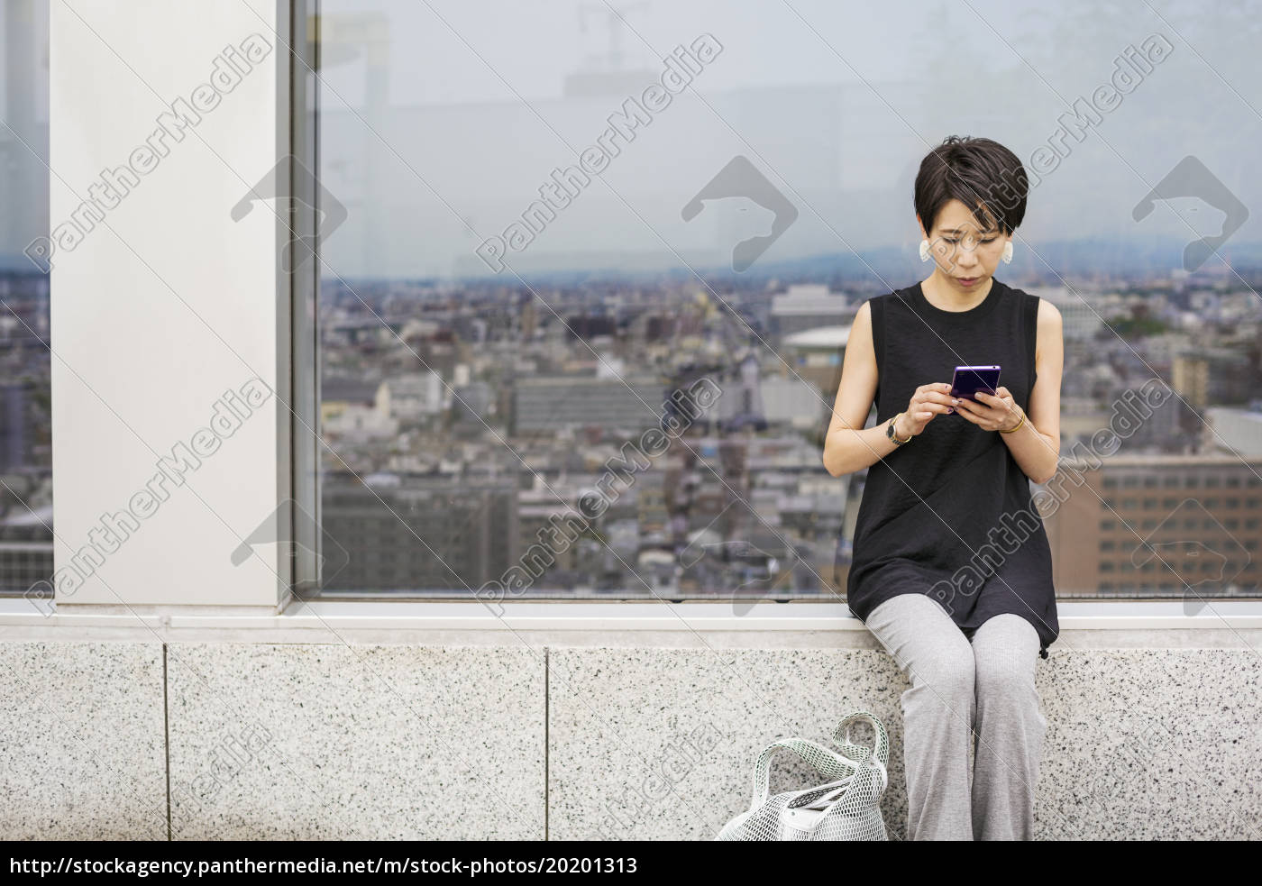 a, woman, seated, by, a, window - 20201313