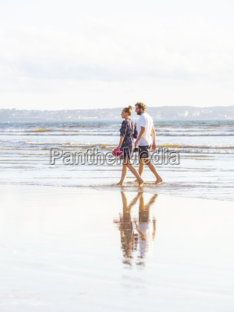 couple talking a beach walk