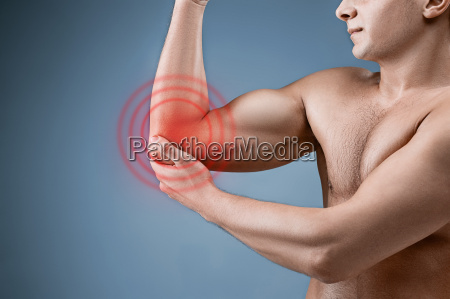 man with pain in elbow pain