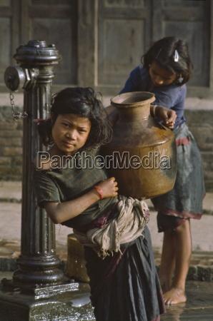 girl carrying water bottle in bhaktapur