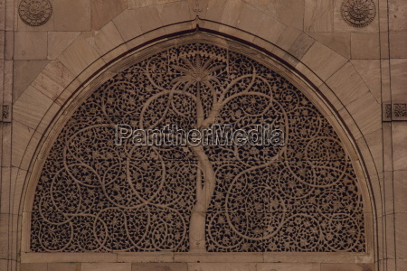 close up of carved stone window