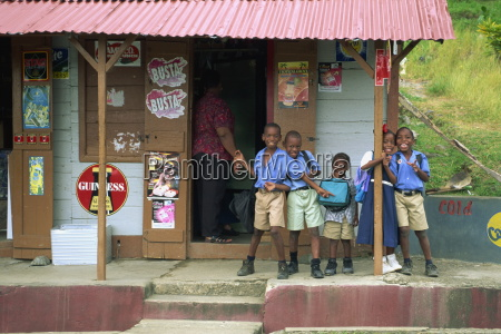 portrait of schoolchildren waiting for bus