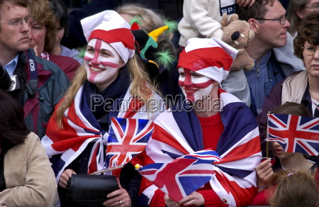 enthusiastic patriots wearing union jack flags