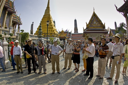 tourists visit the grand palace complex