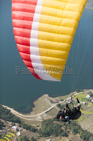 paragliders make their way to the