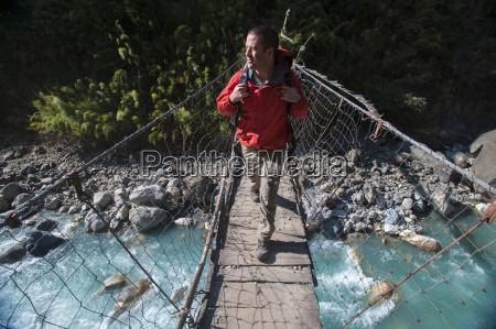 a wire suspension bridge across the